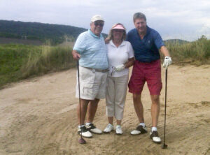 Tony Imperato, Unilever; Cindy Hundley, Spray Publisher; and Pete Erickson, Aptar, playing out of the sand.