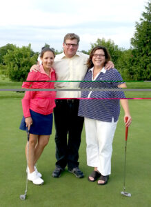 The three finalists of the putting contest. After several rounds, Buckland emerged the winner! Pictured L to R: Alyssa Kowcz, Unilever; George Buckland; Heather Gambose, MicroCare.