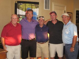 The winning foursome, with Dennis Smith