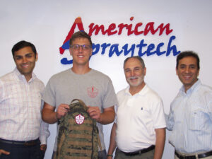 Sgt. Brett D'Allesandro, Backpacks for Life (2nd from left), is flanked by  Manav Lalwani, Bob Daria and Allen Lalwani of American Spraytech