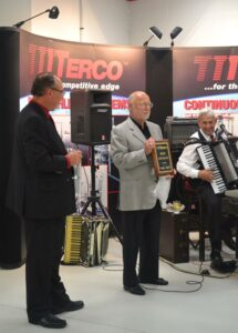 Dennis Ehrens, CEO, receives 50th anniversary plaque