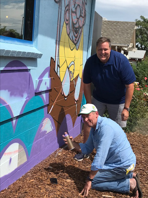John Blum from Ball (top) and John Davis from PLZ (bottom) help out with the mural.